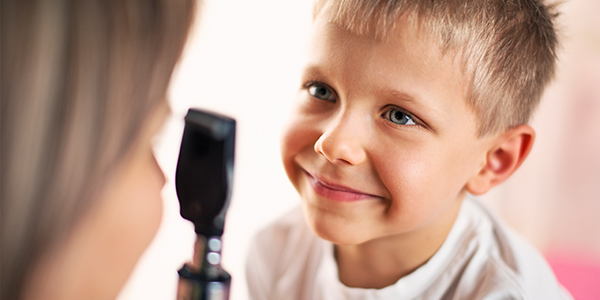 Close up of doctor examining little boy